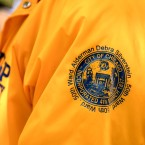 Participants in the community watch program in Rogers Park don orange jackets that were paid for, in part, by the Chicago Police Department.