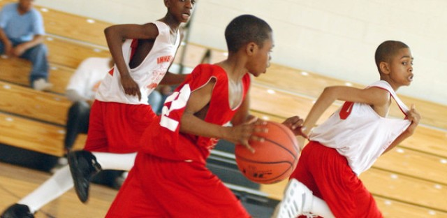 A group of boys play ball in the Windy City Hoops league.