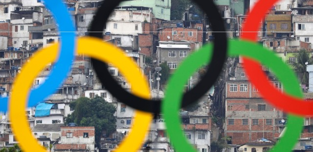 Homes in the Morro Sao Carlos favela stand behind the Olympic rings during an elimination round of the individual archery competition at the Sambadrome venue during the 2016 Summer Olympics in Rio de Janeiro.