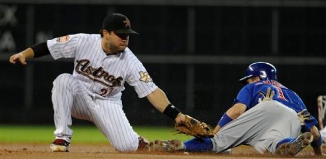 Houston's Jose Altuve tags Campana as he comes into the base.