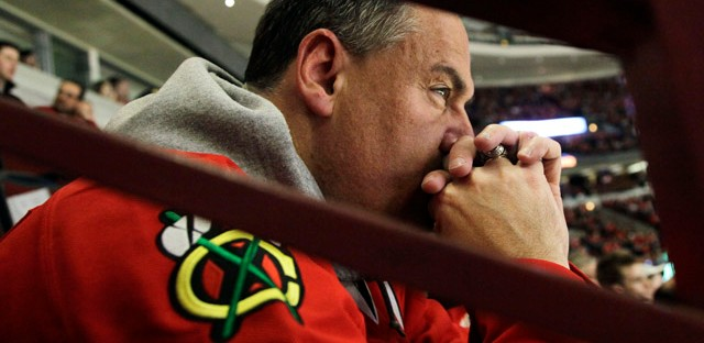 A Blackhawks fan reacts as he watches his team play against the Phoenix Coyotes during Game 6 of the first-round playoffs. The Coyotes won 4-0.