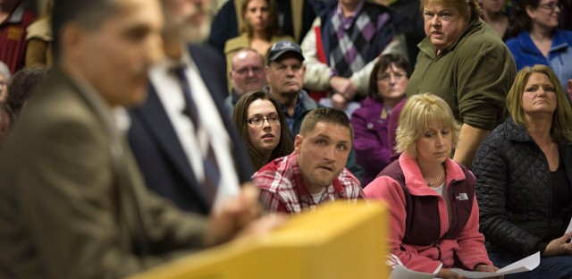 Dudley residents look on as attorney Jason Talerman, right, and civil engineer Imad Zrein present the Muslim cemetery plan for Corbin Road at a packed public hearing on Thursday evening.