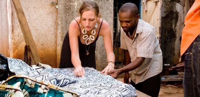 Holly Elzinga and Faustin Bukkedde designing clothes at tailoring workshop in Kampala, Uganda.