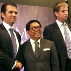 Donald Trump Jr. (left) and Eric Trump (right), sons of President-elect Donald Trump, pose with Philippine real estate developer Jose E.B. Antonio at a 2012 news conference in Manila announcing the launch of the Trump Tower Manila, a $150 million project that is now nearing completion.