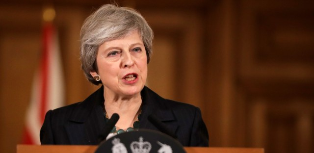 """Britain's Prime Minister Theresa May speaks during a press conference inside 10 Downing Street in London, Thursday, Nov. 15, 2018. British Prime Minister Theresa May says if politicians reject her Brexit deal, it will set the country on """"a path of deep and grave uncertainty."""" Defiant in the face of mounting criticism, May said Thursday she believed """"with every fiber of my being"""" that the deal her government struck with the European Union was the right one."""