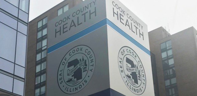A large sign directs Cook County Health patients around the Near West Side medical campus, which includes John H. Stroger Jr. Hospital.