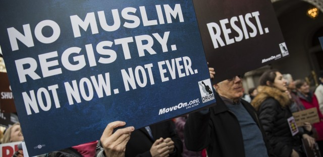Demonstrators march from the Department of Justice to the White House in December 2016 to protest the National Security Entry-Exit Registration System program and then-President-elect Donald Trump's plan to restrict travelers from Muslim countries