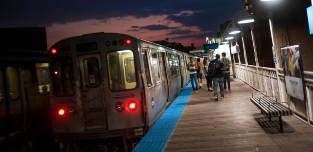 Passengers exit a blue line train at the Damen Blue Line stop in the Wicker Park neighborhood.