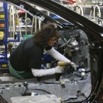 Toyota's plant in Georgetown, Ky., is its largest in the world. In this photo from 2010, an employee installs an accelerator into a new Camry at the plant.