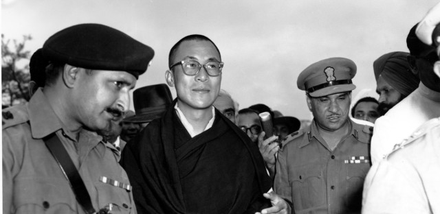 The Dalai Lama, spiritual and temporal head of Tibet, arrives at Tezpur, Assam in India on April 18, 1959. The Dalai Lama, forced into exile after China's suppression of the Tibetan national uprising, made a 300-mile trek over the Eastern Himalayas from Lhasa. He is with attendants who are not identified. (AP Photo)