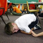 Kindergarten students in Oahu, Hawaii, lie on the floor during a lockdown drill in 2003.