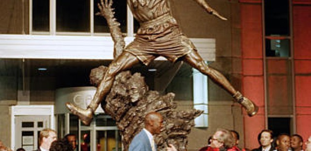 Chicago Bulls' star Michael Jordan stands next to a 12-foot bronze statue of himself unveiled outside the United Center in Chicago, Ill., Nov. 1, 1994, during a salute to Jordan by the Bulls.  At left is Jordan's mother Deloris.