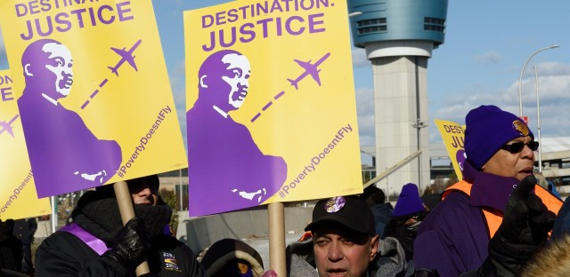 Airport workers rallied Monday for higher wages near LaGuardia Airport in New York City.