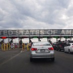 Cars line up to cross into the U.S. at the Canadian border