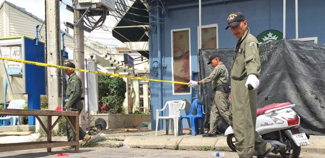 Investigators work at the scene of an explosion in the resort town of Hua Hin, 240 kilometers (150 miles) south of Bangkok, Thailand on Friday. The blast followed a series of two explosions in Hua Hin Thursday evening that left one person dead and a number injured.