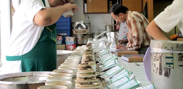 Sujoy Sengupta, a tea taster and blender of Chamong Tee, the largest Darjeeling tea producer, tastes samples.