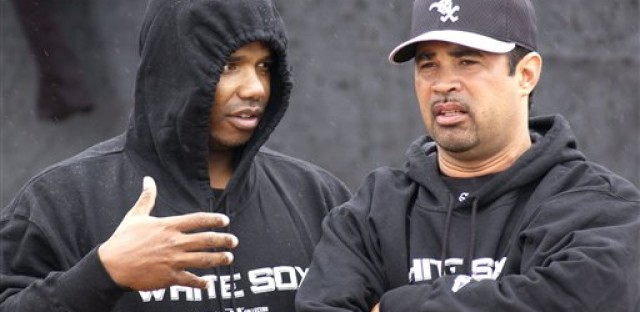 White Sox general manager Ken Williams, left, talks with former manager Ozzie Guillen, right, in 2005.