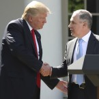 President Trump shakes hands with EPA Administrator Scott Pruitt in 2017, after announcing that the U.S. would pull out of the Paris climate agreement.
