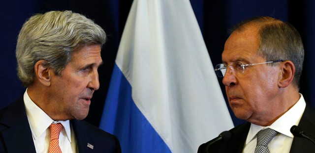 In this Sept. 9, 2016 file-pool photo, Secretary of State John Kerry talks with Russian Foreign Minister Sergei Lavrov during their joint news conference following their meeting to discuss the crisis in Syria, in Geneva, Switzerland.