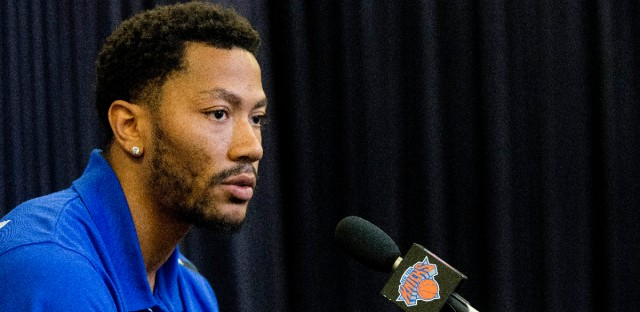 In June, Derrick Rose speaks during a news conference for the New York Knicks to announce they acquired him from the Chicago Bulls at Madison Square Garden in New York. A Los Angeles federal judge ruled Tuesday, Sept. 20, that a woman accusing NBA star Rose of rape cannot remain anonymous at her upcoming civil trial.
