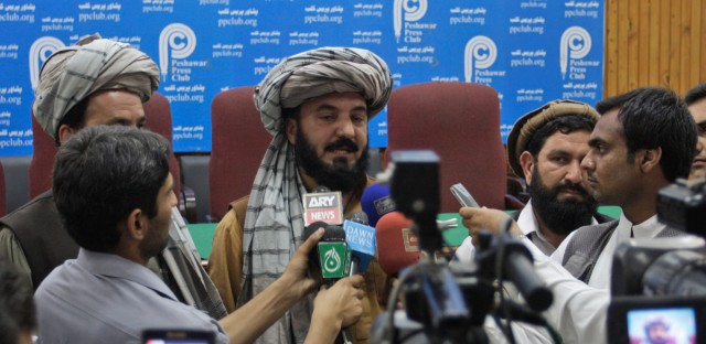 Pakistani tribal elder Malik Jalal, center, flanked by newsmen addresses a news conference to condemn a U. S. drone attack in North Waziristan in 2011.