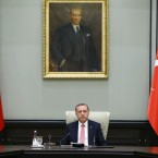 Under a portrait of Turkish Republic founder Mustafa Kemal Ataturk,Turkey's President Recep Tayyip Erdogan chairs the cabinet meeting, in Ankara, Turkey, Monday, July 25, 2016. Turkey on Monday issued warrants for the detention of 42 journalists suspected of links to the alleged organizers of a failed military uprising, intensifying concerns that a sweeping crackdown on alleged coup plotters could target media for any news coverage critical of the government.