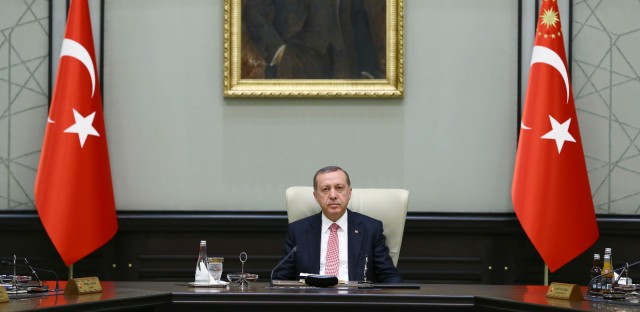Under a portrait of Turkish Republic founder Mustafa Kemal Ataturk,Turkey's President Recep Tayyip Erdogan chairs the cabinet meeting, in Ankara. Turkey on Monday issued warrants for the detention of 42 journalists suspected of links to the alleged organizers of a failed military uprising, intensifying concerns that a sweeping crackdown on alleged coup plotters could target media for any news coverage critical of the government.