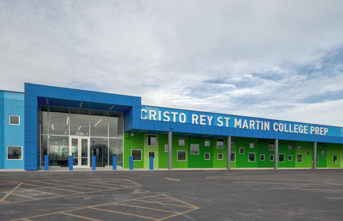 The entrance of Cristo Rey St. Martin College Prep is painted blue and shades of bright green.