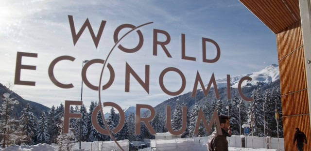 A man walks at the main entrance of the congress center where the World Economic Forum took place in Davos, Switzerland, Monday Jan. 18, 2016. The world's political and business elite are being urged to do more than pay lip service to growing inequalities around the world.