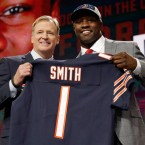 Commissioner Roger Goodell, left, presents Georgia's Roquan Smith with his Chicago Bears jersey during the first round of the NFL football draft, Thursday, April 26, 2018, in Arlington, Texas.