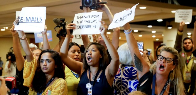 Protesters yell as DNC Chairwoman, Debbie Wasserman Schultz, D-Fla., arrives for a Florida delegation breakfast, Monday, July 25, 2016, in Philadelphia, during the first day of the Democratic National Convention.