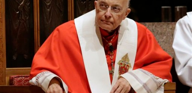 FILE - In this Nov. 17, 2014 file photo, retiring Cardinal Francis George listens at Holy Name Cathedral in Chicago during Bishop Blase Cupich's Rite of Reception service.