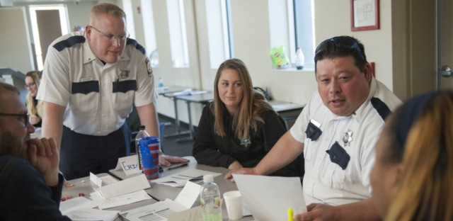 Illinois Department of Corrections officers participate in a role-playing exercise during a March training session on working with female inmates, at Logan Correctional Center in Lincoln, Ill. Bill Healy for SJNN