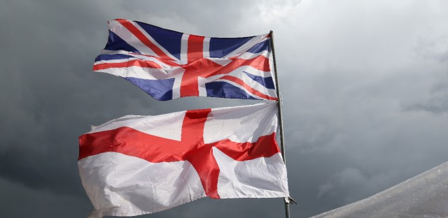 The flag of the United Kingdom of Great Britain and Northern Ireland, top, and the flag of England fly above a souvenir stand on Westminster Bridge. Britain voted to leave the European Union after a bitterly divisive referendum campaign.