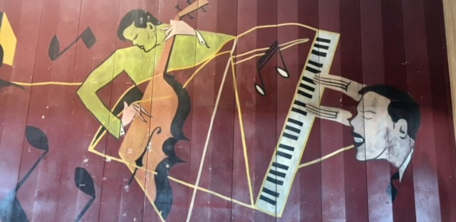 A legendary Jazz Age mural in the onetime Sunset Cafe building is on full-time public display in a store at 315 E. 35th Street.