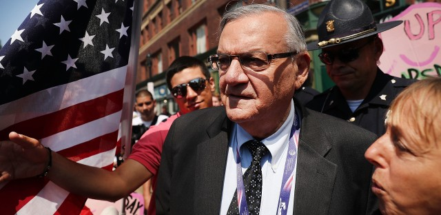 Former Maricopa County Sheriff Joe Arpaio surrounded by protesters and members of the media at the the Republican National Convention in Cleveland last summer.