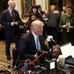 President Trump participates in a series of radio interviews in the Indian Treaty Room of the Eisenhower Executive Office Building on Tuesday. Among the topics he discussed was his and past presidents' policies on reaching out to families of service members who have died.