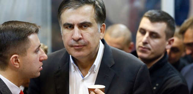Former Georgian President Mikheil Saakashvili, center, listens to his lawyer in a court room in Kiev, Ukraine, Monday, Dec. 11, 2017. Saakashvili, the adamant opposition leader who was stripped of his Ukrainian citizenship four months ago, was arrested late Friday, Dec. 8, in Ukraine's capital.
