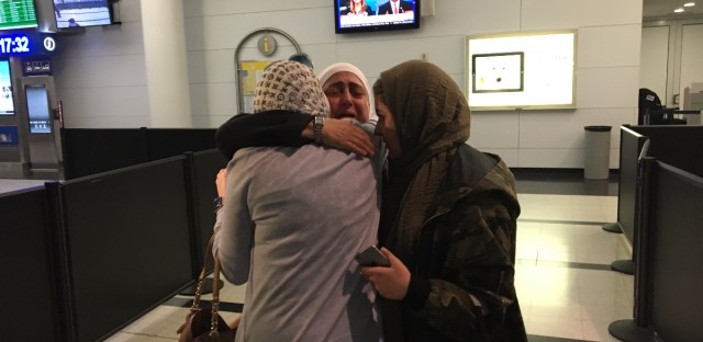 Sahar Algonaimi (center) arrived at O'Hare International Airport to reunite with her sister, Nour Ulayyet (left) and niece, Maria Ulayyet (right). Algonaimi, a Syrian national who lives in Saudi Arabia, was denied entry to the U.S. when she landed at O'Hare three weeks ago, due to the travel ban.