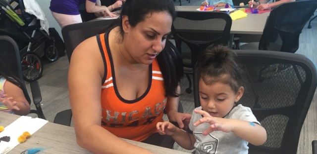 Diane Boudakh helps her daughter make a puppet at a play group in Skokie hosted by Ready For Success. The goal is to reach public school students well before they begin kindergarten.