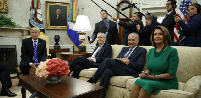 Senate Minority Leader Chuck Schumer, D-N.Y., House Minority Leader Nancy Pelosi, D-Calif., and Senate Majority Leader Mitch McConnell, R-Ky., at an Oval Office meeting with President Trump in September. The top Democrats have pulled out of a similar meeting planned for Tuesday afternoon.