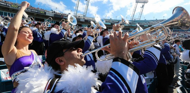 The Northwestern University 'Wildcat' Marching Band celebrates victory at EverBank Field at the 2013 TaxSlayer.com Gator Bowl, where Northwestern competed against Mississippi State on January 1, 2013.
