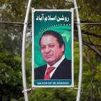 A billboard shows the portrait of Pakistani Prime Minister Nawaz Sharif displayed along a main highway in Islamabad, Pakistan, Friday, July 28, 2017. Pakistan's Supreme Court in a unanimous decision has asked the country's anti-corruption body to file corruption charges against Sharif, his two sons and daughter for concealing their assets.