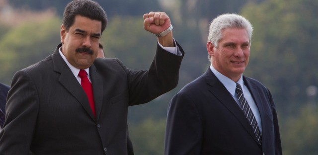 Venezuela's President Nicolas Maduro, left, flanked by Cuba's Vice-president Miguel Diaz Canell, arrive to the Plaza de la Revolucion, in Havana, Cuba, Friday, March 18, 2016. Venezuela's President Maduro flew to Cuba on Friday for a day of high-level meetings and ceremonies that appeared designed to send a message of socialist solidarity two days before Barack Obama becomes the first U.S. president to visit the island in nearly 90 years.