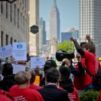 "Striking independent drivers rally outside Uber and Lyft offices, calling for ""fair pay for all drivers,"" Wednesday May 8, 2019, in New York."