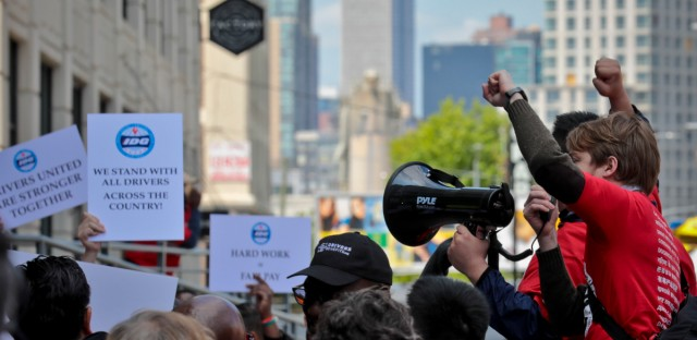 """Striking independent drivers rally outside Uber and Lyft offices, calling for """"fair pay for all drivers,"""" Wednesday May 8, 2019, in New York."""