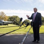 President Trump takes questions from reporters before boarding Marine One on the South Lawn of the White House on Friday. Drew Angerer/Getty Images