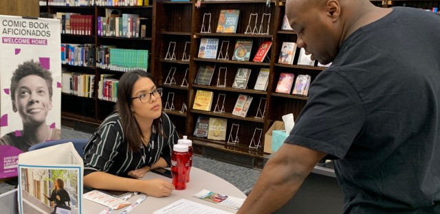 census recruiting assistant talks with resident