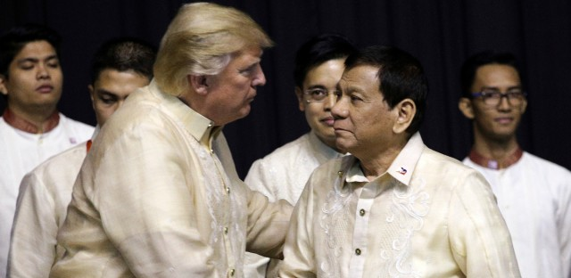 President Donald Trump shakes hand with Philippines President Rodrigo Duterte during the gala dinner marking ASEAN's 50th anniversary in Manila, Philippines, Sunday Nov. 12, 2017.