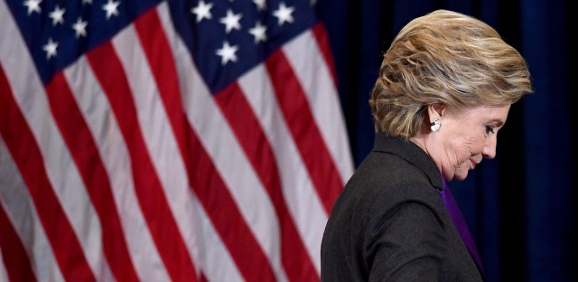 Hillary Clinton steps down a staircase after making a concession speech following her defeat to Republican President-elect Donald Trump on November 9, 2016.